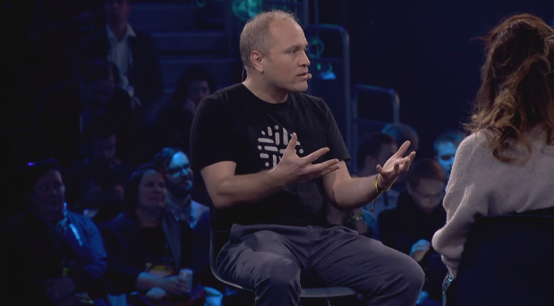 Stijn Christiaens on stage at Slush.